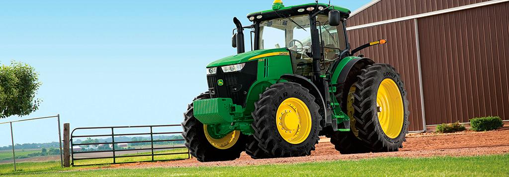Illustrasjon av John Deere-traktor med aircondition.